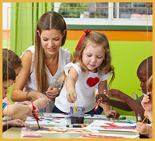 Teacher helps students painting in class