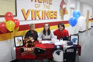 Makensie Rawlins with two staff members