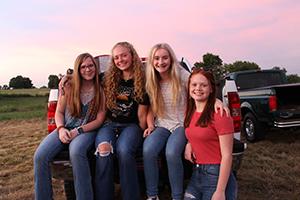 Students enjoying back-to-school bonfire