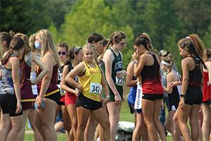 Female runners waiting at starting line