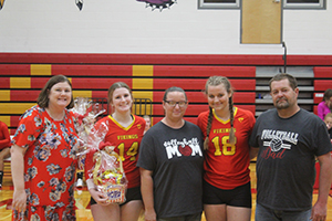 Senior volleyball athletes with their families