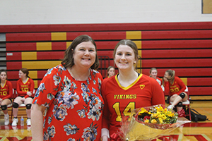 Senior volleyball athlete posing for a picture with her mother
