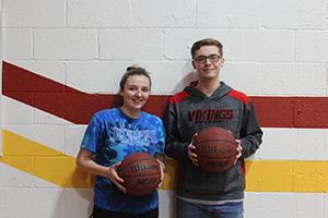 Liz Morris and Skylar DeClue pose with basketballs