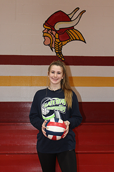 Female volleyball player holding a ball
