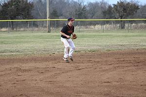 Ethan Matthews on the baseball field holding a baseball glove