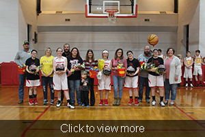 Eighth grade girls pose with their parents