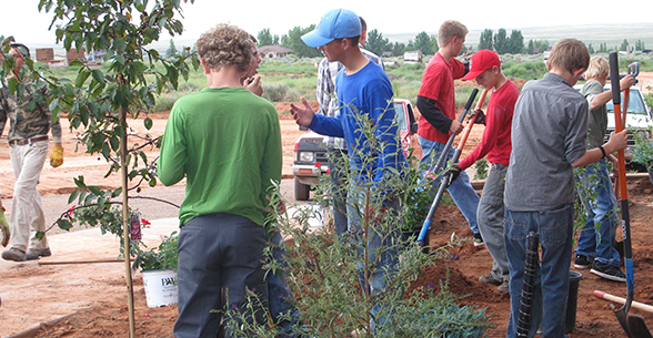 Students participate in an outdoor gardening and planting activity