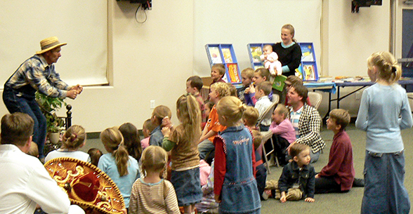 Students and staff members participate in a storytime activity
