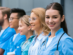 Health students in a row wearing blue jackets