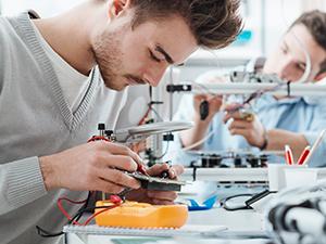 Student working on circuit repair