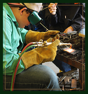 Welding student working with a teacher