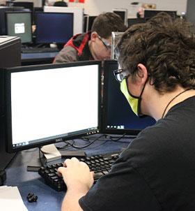 Student at desktop computer
