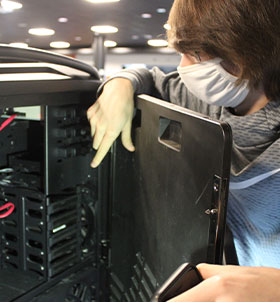Student working on open computer tower