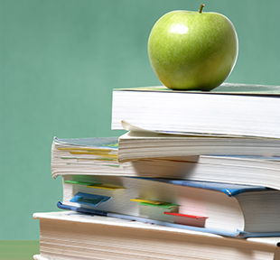 Apple sitting on a stack of books