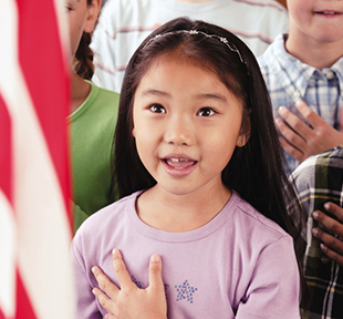 Female student reciting the pledge of allegiance