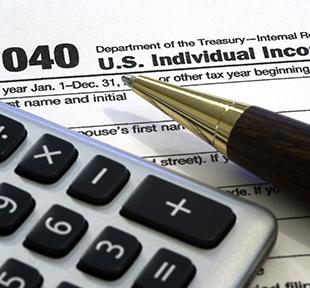 Tax form, calculator and a pen
