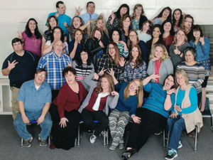 Pima Elementary School Faculty and Staff posing together and making silly faces
