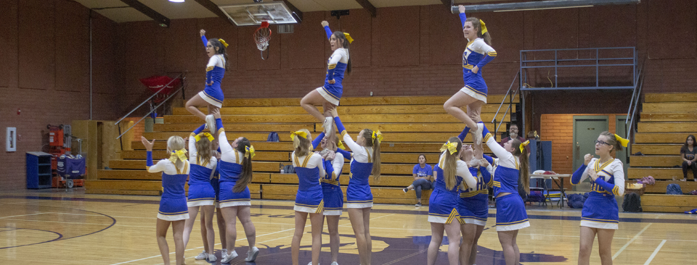 Cheerleaders cheering in a gym