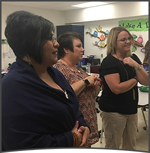 Staff - 3 women in a classroom