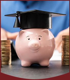Pink piggy bank wearing a graduation cap
