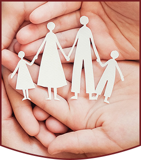 Adult and children hands holding paper family cutout