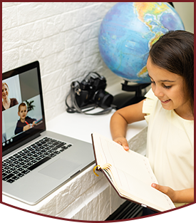 Young female student engaged with her online class from home