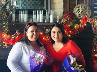 Anna Grijalva and Aracely Caballero holding flowers