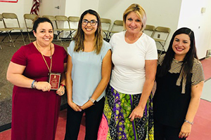 Anna Grijalva and administration with her award
