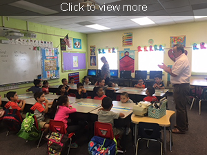 Teacher speaking to students in the classroom