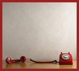 retro red telephone with receiver