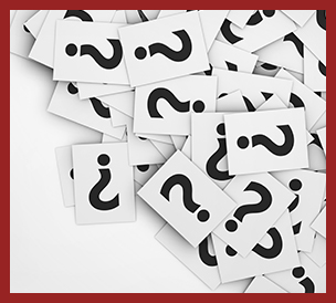 scattered pile of question marks on cards