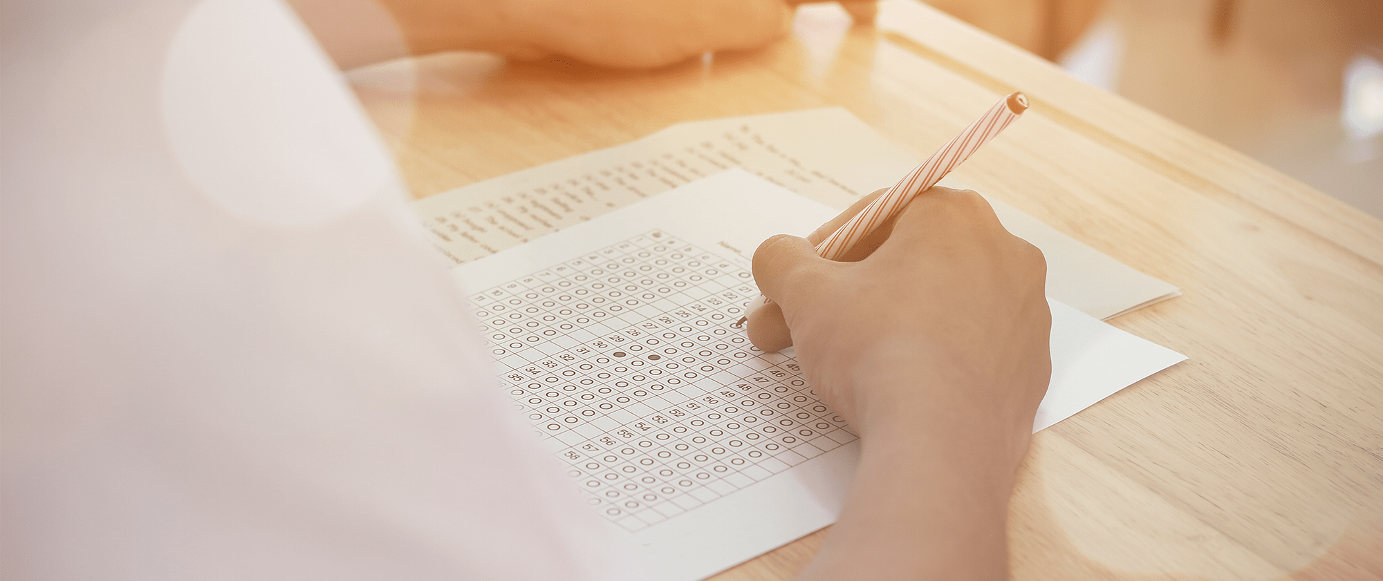 Closeup of student filling in a bubble on a test sheet