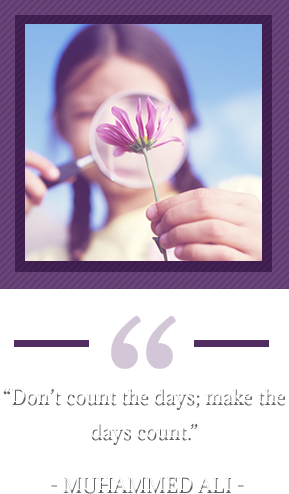 """Don't count the days; make the days count."" – Muhammed Ali. Girl looking at flower through magnifying glass"