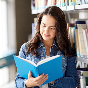 Student reads in a library