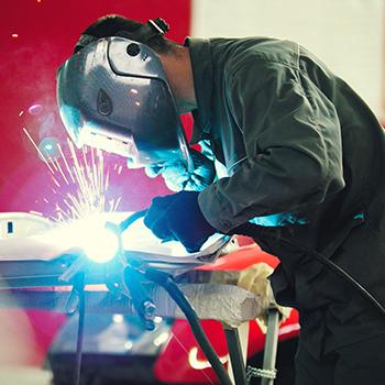 Welder uses tools