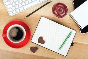 Coffee table with coffee mug, cookies, and an apple