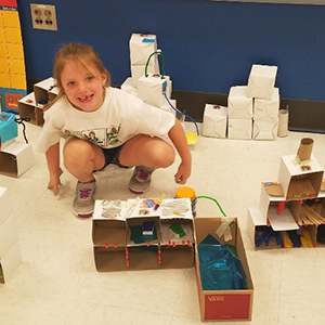 Student participates in a camp invention activity