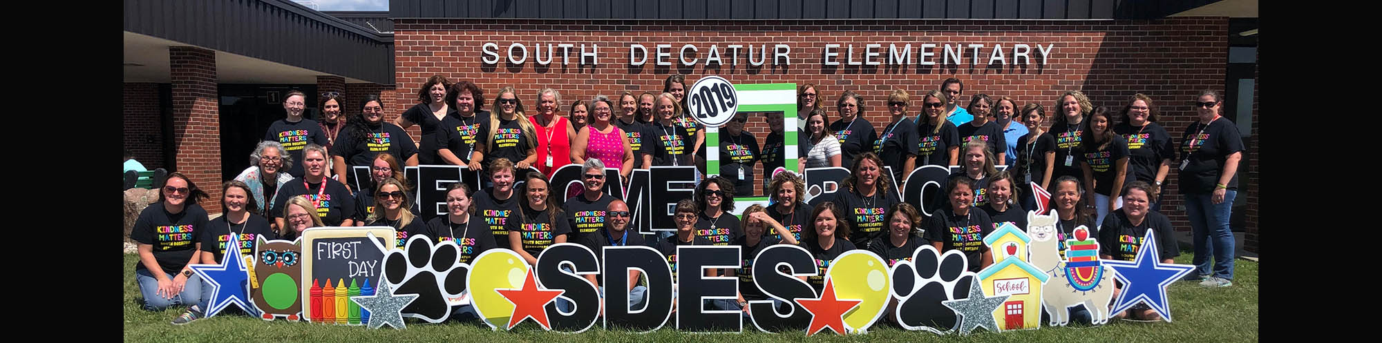 South Decatur Elementary friendly staff in front of their school building