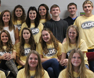 Rows of students wearing SADD t-shirts pose together
