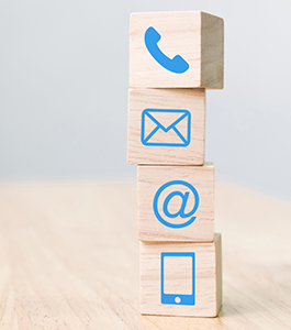 Telephone, smartphone, mail and at icons on blocks