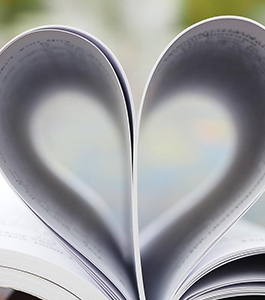 Book pages forming a heart
