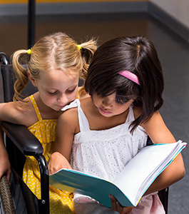 Two female students reading together