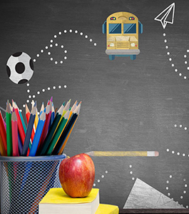 School bus, soccer ball, paper, pencil and paper plane on a blackboard behind colored pencils and an apple stacked on top of books
