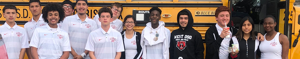 tennis students in front of bus