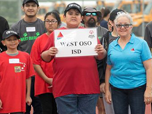 Group of West Oso ISD supporters holding up a West Oso ISD sign