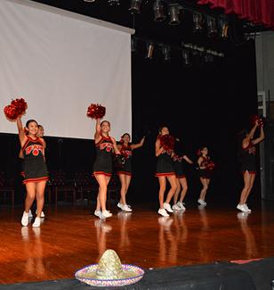 cheerleaders cheering on stage