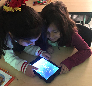 two students looking at tablet