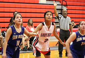 Female basketball player waiting to rebound