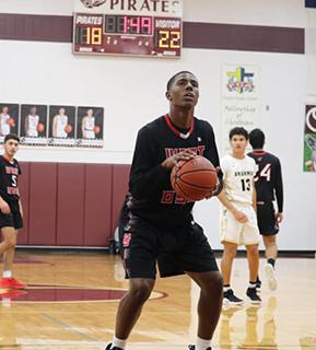 Basketball player shoots a hoop