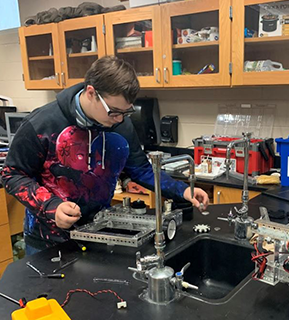 Student working on robotics project